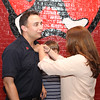Beth Campagna pins the Lieutenant badge on her husband Jon