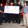 The Fitchburg Firefighter's Local 3128 presented a check for $16,020 to the Muscular Dystrophy Association, the proceeds from the union's annual boot drive held earlier this month. From left are Capt. Anthony Marrama, firefighters Jarrod Roy, Sean Roy and John Girouard, and MDA fundraising coordinator William Southall.  Courtesy Fitchburg Fire Department