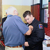William Schofield get his badge gets pinned on by his grandfather Ret Leominster Ff Wayne Schofield