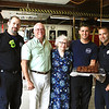Jack and Linda Kinsey dropped off brownies to the Leominster Fire Department on Sept. 11, which is a tradition they have continued since the attacks in 2001. The Kinseys are joined by, from left, firefighters Eric Falk, Jon Williams and Lt. Bryan LeBlanc. SENTINEL & ENTERPRISE/SCOTT LAPRADE