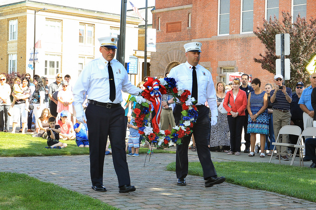 . Chief Robert Sideleau II and Lt.Shane Newton President of the Leominster Ff\'s Reilef Assocation carry the wreath to the memorial SENTINEL&ENTERPRISE/Scott LaPrade
