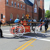 Ff's push and pull the 1800's handtub over to the memorial SENTINEL&ENTERPRISE Scott LaPrade