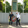 Ff Robert Penning President of the Ff's Relief Assoc. and Chief Robert Sideleau II place the wreath at the monument