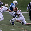 Leominster High School football played Doherty Memorial High School on Saturday night at Doyle Field in Leominster. DMHS's #3 Jon Mejia and #10 Thomas Murray try and stop LHS's #9 Caeden Constant. SENTINEL & ENTERPRISE/JOHN LOVE