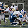 Leominster High School football played Doherty Memorial High School on Saturday night at Doyle Field in Leominster. LHS's #4 Vo'shon Dixon and #33 Jack Philbin try and stop DMHS's #5 Jairon Vega. SENTINEL & ENTERPRISE/JOHN LOVE