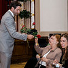 Ryan Logan hands out roses to his family members during the Leominster Gents, Putting on the Threads Fashion Show at City Hall on Thursday evening. SENTINEL & ENTERPRISE / Ashley Green
