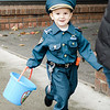 Luke Cappucci, 3, participates in downtown trick-or-treating in Leominster on Saturday afternoon. SENTINEL & ENTERPRISE / Ashley Green
