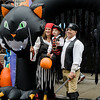Audra and Mike Kirtland along with Shane, 3 participate in downtown trick-or-treating in Leominster on Saturday afternoon. SENTINEL & ENTERPRISE / Ashley Green