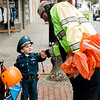 Lt. Rich Kinney stops to greet Luke Cappucci, 3, downtown trick-or-treating in Leominster on Saturday afternoon. SENTINEL & ENTERPRISE / Ashley Green