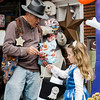 Mayor Dean Mazzarella hands out candy to Ava Marchione during downtown trick-or-treating in Leominster on Saturday afternoon. SENTINEL & ENTERPRISE / Ashley Green