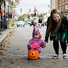 Sienna, 3, and Elizabeth, take a break during downtown trick-or-treating in Leominster on Saturday afternoon. SENTINEL & ENTERPRISE / Ashley Green