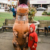 Matthew Duuval, 5, meets a dinosaur participate in downtown trick-or-treating in Leominster on Saturday afternoon. SENTINEL & ENTERPRISE / Ashley Green
