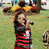 Lincoln Walsh, 4,  participate in downtown trick-or-treating in Leominster on Saturday afternoon. SENTINEL & ENTERPRISE / Ashley Green
