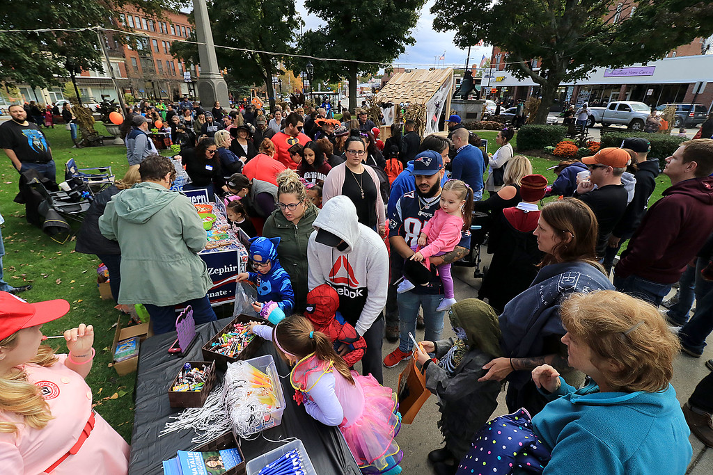 . The annual Halloween parade in Leominster was held on Saturday, October 20, 2018 in down town around Monument Square. The business were handing out candy to all the kids and the common was cover in tables with all the politicians  handing out candy. The common was covered with trick or treaters looking for candy. SENTINEL & ENTERPRISE/JOHN LOVE