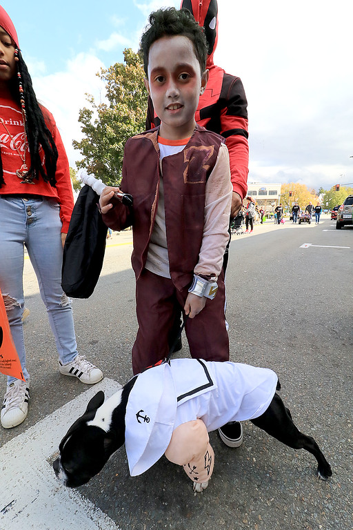 ". The annual Halloween parade in Leominster was held on Saturday, October 20, 2018 in down town around Monument Square. The business were handing out candy to all the kids and the common was cover in tables with many politicians. Ziah Del Vlle, 8, dressed as Zed from the Disney Movie ""Zombies\"" walked with his dog Nitro, a Boston Terrier, in the parade. SENTINEL & ENTERPRISE/JOHN LOVE"