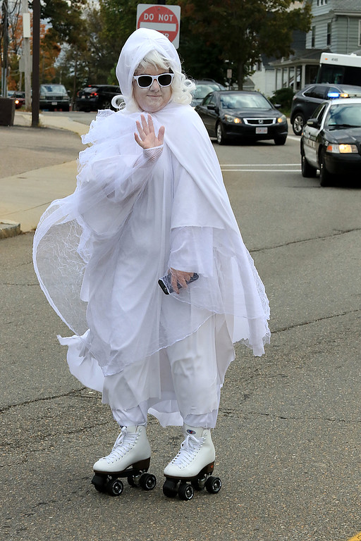 . The annual Halloween parade in Leominster was held on Saturday, October 20, 2018 in down town around Monument Square. The business were handing out candy to all the kids and the common was cover in tables with many politicians. this roller skating ghost was Wendy Wiiks of the mayors office. SENTINEL & ENTERPRISE/JOHN LOVE