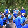 Coach Palazzi gives the team a pep talk