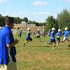 Coach Palazzi watches players run sprint drills