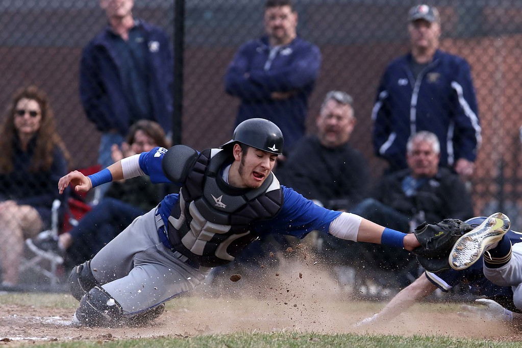 . Leominster High School baseball team played Shrewsbury High School at Doyle field in Leominster. Leominster Catcher Rocco Pandisscio reaches to tag out SHS player Tyler Hopping. SENTINEL & ENTERPRISE/JOHN LOVE
