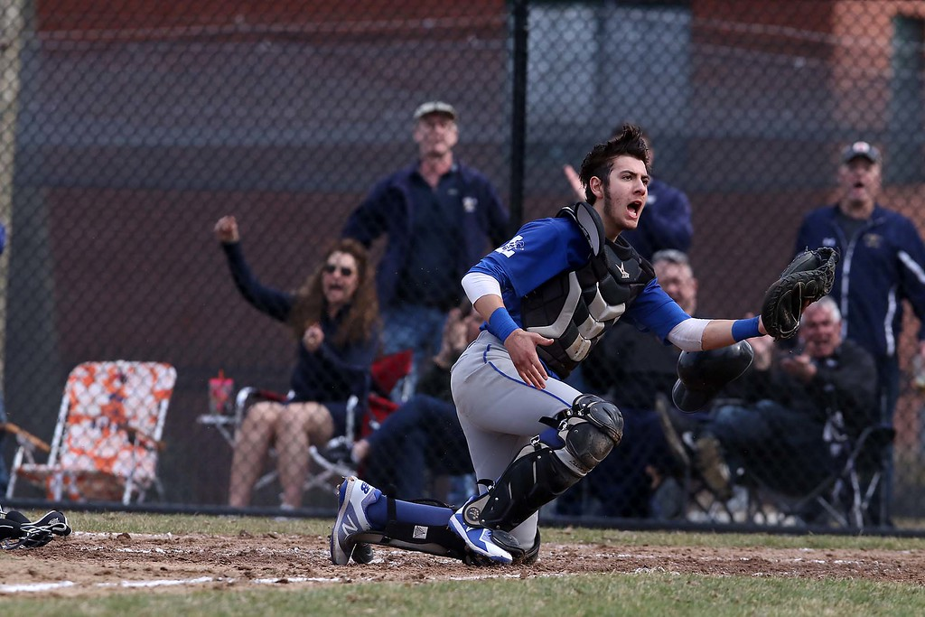 . Leominster High School baseball team played Shrewsbury High School at Doyle field in Leominster. Leominster Catcher Rocco Pandiscio tries to pled his case that he tagged out SHS player Tyler Hopping at the plate during the game. SENTINEL & ENTERPRISE/JOHN LOVE