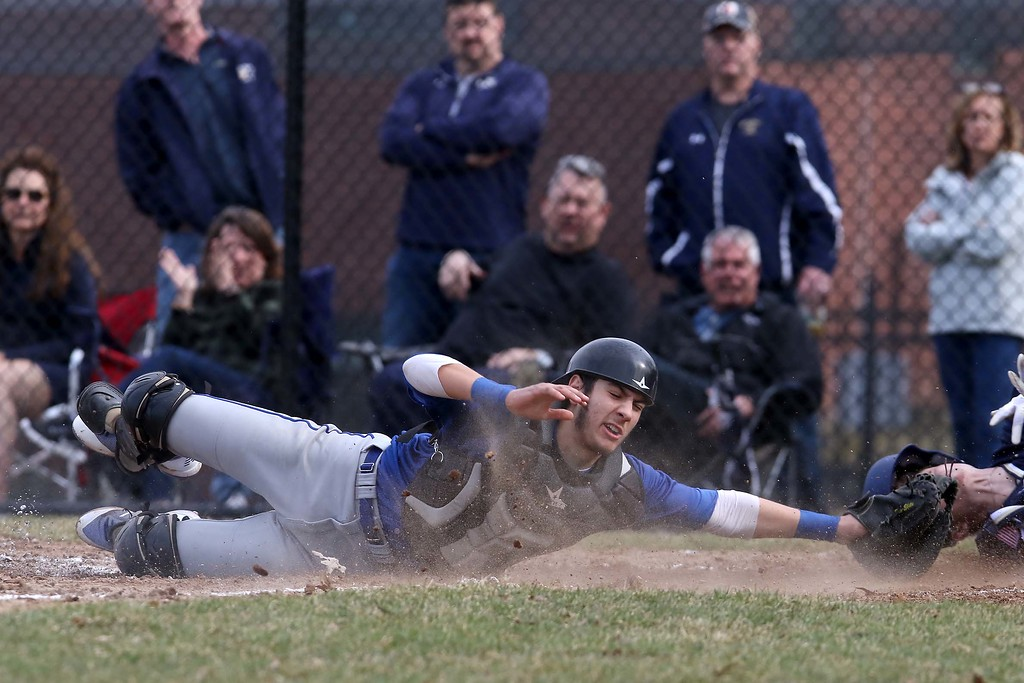 . Leominster High School baseball team played Shrewsbury High School at Doyle field in Leominster. Leominster Catcher Rocco Pandiscio reaches to tag out SHS player Tyler Hopping. SENTINEL & ENTERPRISE/JOHN LOVE
