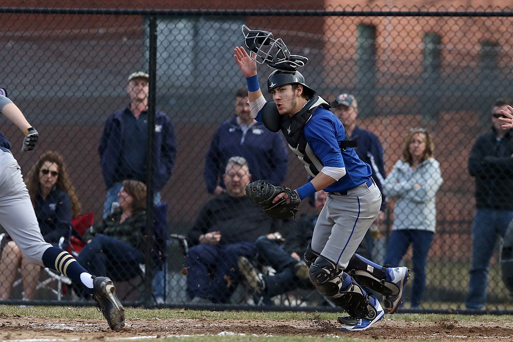 . Leominster High School baseball team played Shrewsbury High School at Doyle field in Leominster. Leominster Catcher Rocco Pandisscio throws off his mask as he gets readyt to run dow a SHS player that was trying to get back to third after trying to run home. . SENTINEL & ENTERPRISE/JOHN LOVE