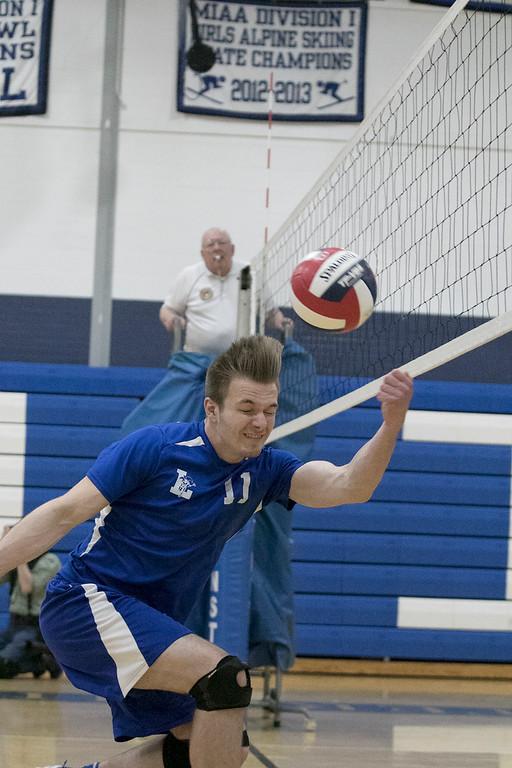 . Leominster High School\'s Volleyball player Kurt Edmands dives for the ball. SENTINEL & ENTERPRISE/JOHN LOVE