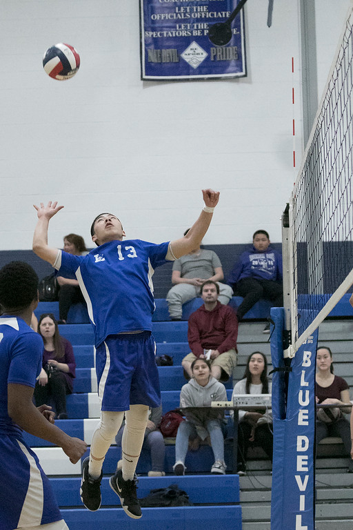 . Leominster High School volleyball player Jon Cha goes up to get the ball during action in the game. SENTINEL & ENTERPRISE/JOHN LOVE