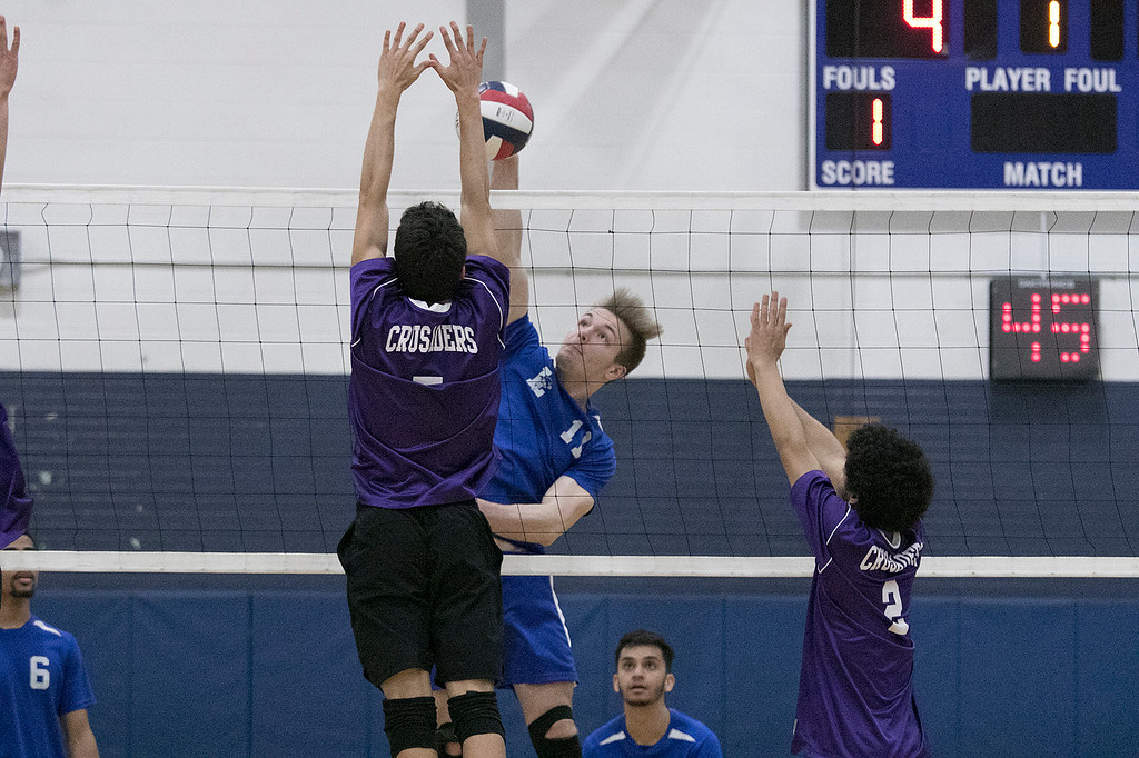 . Leominster High School volleyball player Kurt Edmands leaps to spike the ball during action in the game. SENTINEL & ENTERPRISE/JOHN LOVE