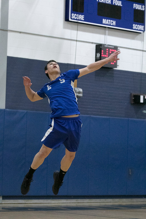 . Leominster High School volleyball player Eric Jenny serves the ball. SENTINEL & ENTERPRISE/JOHN LOVE