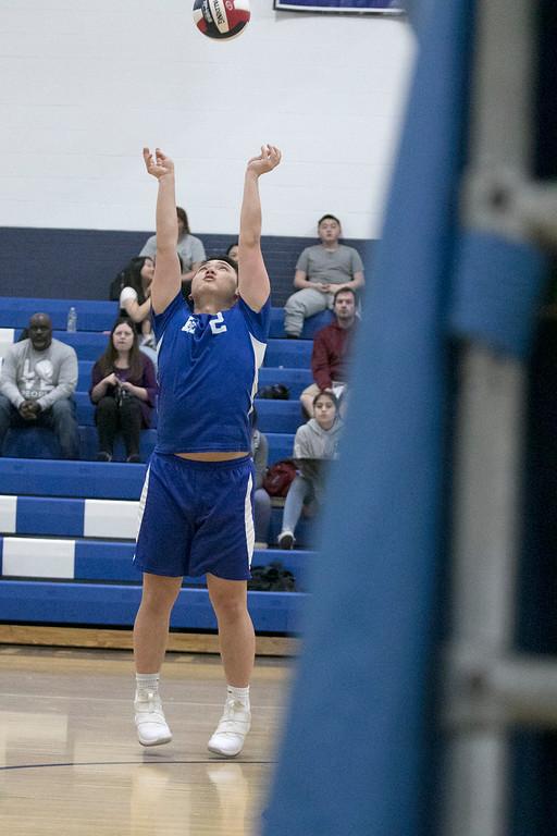 . Leominster High School volleyball player Seeley Thao sets the ball. SENTINEL & ENTERPRISE/JOHN LOVE