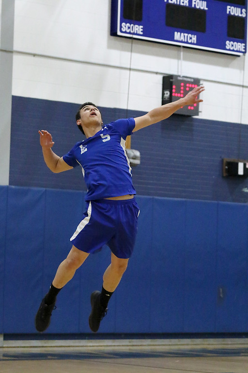 . Leominster High School volleyball player Eric Jenny serves the ball. SENTINEL & ENTERPRISE/JOHN LOVE