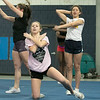 The Leominster High School cheerleading squad at practice on Thursday afternoon, Nov. 21, 2019. Senior Bella Salvatelli, in pink, runninng through their routine. SENTINEL & ENTERPRISE/JOHN LOVE