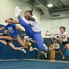 The Leominster High School cheerleading squad at practice on Thursday afternoon, Nov. 21, 2019. In front leading this jump during their routine is junior Curnija Ludden. SENTINEL & ENTERPRISE/JOHN LOVE