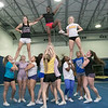The Leominster High School cheerleading squad at practice on Thursday afternoon, Nov. 21, 2019. From left being held in the air is senior Kaity Carco, sophomore Tiffany Boasiako and junior Abbi McDowell. SENTINEL & ENTERPRISE/JOHN LOVE