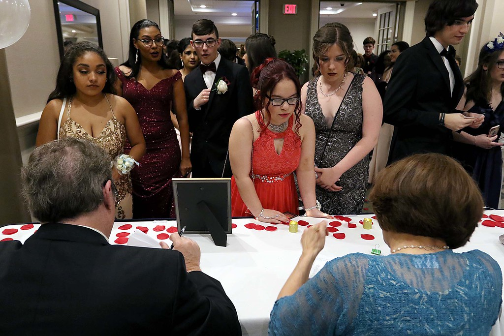 . Students Check into the Leominster High School Prom at the DoubleTree by Hilton Hotel Leominster on Saturday night, May 12, 2018. SENTINEL & ENTERPRISE/JOHN LOVE