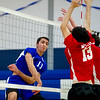 Leominster senior captain Kevin Barbara (#11) spikes the ball through a block attempt by Athol during Thursday's boys varsity volleyball match up at Leominster High School on March 30, 2017. (Sentinel & Enterprise photo/Jeff Porter)