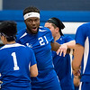 Leominster senior  Princely Tamfu (#21) celebrates a 3-0 win over Athol after Thursday's boys varsity volleyball match up at Leominster High School on March 30, 2017. (Sentinel & Enterprise photo/Jeff Porter)