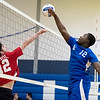 Athol senior Mikey Gray (left) attempts to block Leominster senior captain Isaac Annan (right) during Thursday's boys varsity volleyball match against Athol at Leominster High School on March 30, 2017. (Sentinel & Enterprise photo/Jeff Porter)