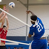 Leominster senior Princely Tamfu (#21) hits the ball over the net during Thursday's boys varsity volleyball match against Athol at Leominster High School on March 30, 2017. (Sentinel & Enterprise photo/Jeff Porter)