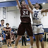 Leominster High School boys basketball played Groton Dunstable Regional High School on Friday night, Jan. 10, 2020 in Leominster. GDRHS's #24 Joe O'Malley puts up a shot as LHS's #12 Brian Perez tries to stop him. SENTINEL & ENTERPRISE/JOHN LOVE