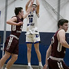 Leominster High School boys basketball played Groton Dunstable Regional High School on Friday night, Jan. 10, 2020 in Leominster. GDRHS's Kyle Plausse jumps to stop a shot by LHA's #10 Trey LeBlanc. SENTINEL & ENTERPRISE/JOHN LOVE