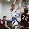 Leominster High School boys basketball played Groton Dunstable Regional High School on Friday night, Jan. 10, 2020 in Leominster. LHS's #11 Liam Connacher puts up a shot over GDRHS's #34 Tristan Chase. SENTINEL & ENTERPRISE/JOHN LOVE