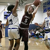 Leominster High School boys basketball played Groton Dunstable Regional High School on Friday night, Jan. 10, 2020 in Leominster. GDRHS's #5 Ryan Harris puts up a shot as LHS's #12 Brian Perez tries to stop him. SENTINEL & ENTERPRISE/JOHN LOVE