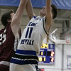 Leominster High School boys basketball played Groton Dunstable Regional High School on Friday night, Jan. 10, 2020 in Leominster. GDRHS's #25 Zack Millett tries to stop a shot by LHS's #11 Liam Connacher. SENTINEL & ENTERPRISE/JOHN LOVE