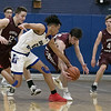 Leominster High School boys basketball played Groton Dunstable Regional High School on Friday night, Jan. 10, 2020 in Leominster. LHS's #12 Brain Perez and GDRHS's #24 Joe O'Malley fight for a loose ball. SENTINEL & ENTERPRISE/JOHN LOVE
