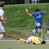 Leominster High School boys soccer played Nashoba Regional High School on Wednesday, September 4, 2019 at Doyle Field in Leominster. LHS's Uriel Alfaro leaps over NRHS's goalie Thiago Delmonego during action in the game. SENTINEL & ENTERPRISE/JOHN LOVE