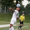 Leominster High School boys soccer played Nashoba Regional High School on Wednesday, September 4, 2019 at Doyle Field in Leominster. NRH's Calvin Cochrane heads the ball. SENTINEL & ENTERPRISE/JOHN LOVE