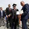 Leominster high School class of 2018 held their 148th commencement on Saturday, June 2, 2018. Mayor Dean Mazzarella, on right, gives WWII veteran Roland Martineau, 94, his well overdue Leominster High School diploma at the start of the ceremony. Just behind Martineau is City Councilor Frank Ardinger,  Director of Veterans Services for Leominster Rick Voutour and Army retired Master Sgt. Dennis Lyddy. SENTINEL & ENTERPRISE/JOHN LOVE
