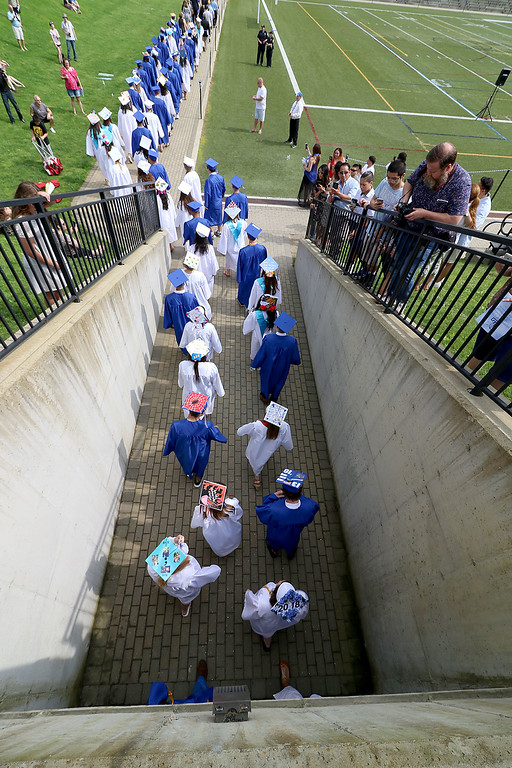. Leominster high School class of 2018 held their 148th commencement on Saturday, June 2, 2018. The graduates march out of the tunnel and on to the football field to start the ceremony. SENTINEL & ENTERPRISE/JOHN LOVE
